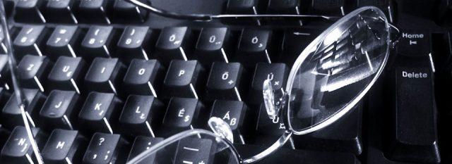 Eye doctor, eyeglasses on a keyboard in Carrollton, TX