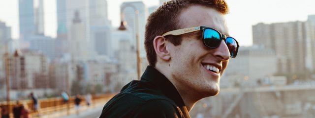 Eye doctor, happy man wearing sunglasses in Carrollton, TX