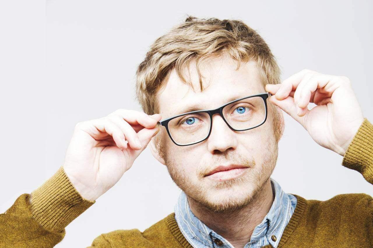 BB Hero male trying on glasses 1280×853.jpg