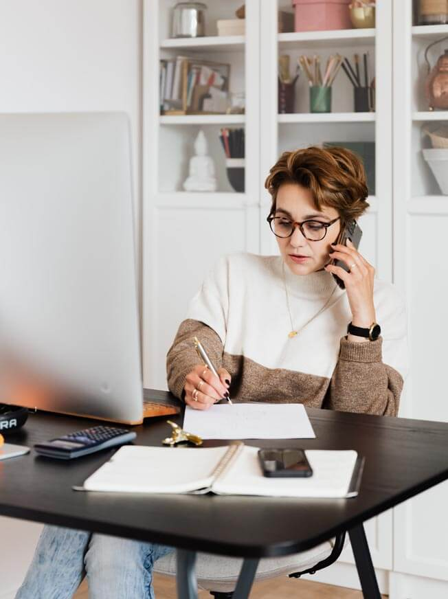 woman making appointment on phone