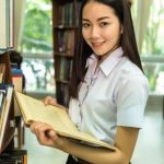 Girl with book in Library - Optometrist - Plano, TX