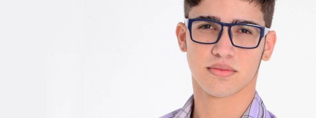 Eye care, teenager wearing astigmatism eyeglasses in Plano, TX
