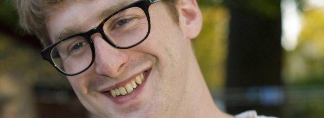 Eye care, young man wearing eyeglasses in Plano, TX