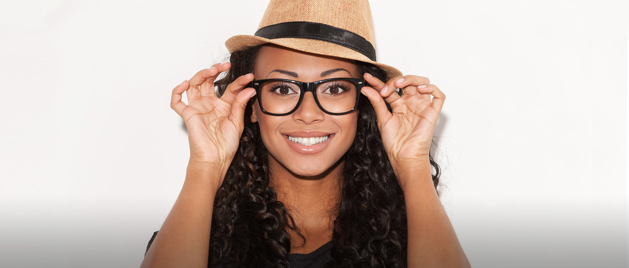 3dfd086075f1 Glasses On Smiling Woman 2000×853 lo