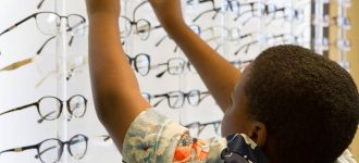 boy_choosing_frames 330x150