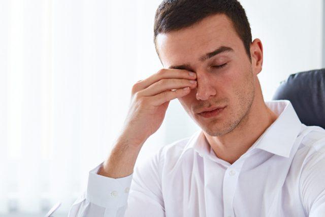 Eye doctor, man rubbing his eyes in Ripley, TN
