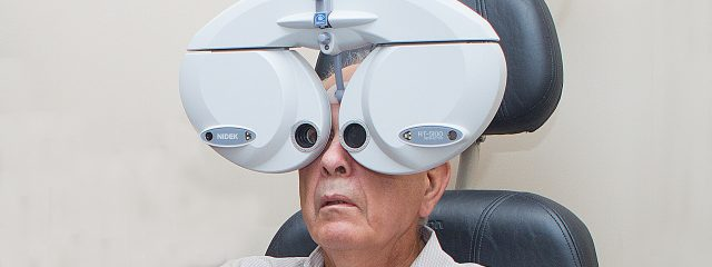 Optometrist, senior man using a phoropter in Cobble Hill, Duncan, Lake Cowichan and Chemainus, BC
