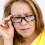 Woman wearing traditional eye glasses, Eye Doctor in Cobble Hill, BC