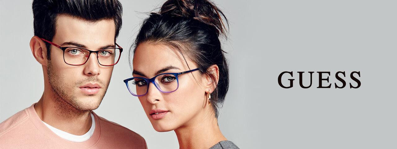 Man and woman wearing Guess Eyelasses