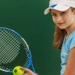Eye doctor, girl smiling, holding a tennis racket in Ashburn, VA