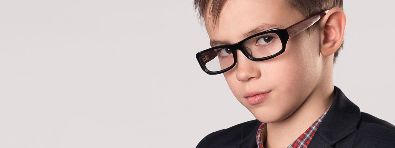 Boy wearing eyeglasses in Hemlock and Saginaw, MI