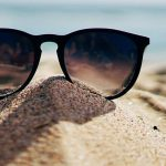 Pair of sunglasses on sand in Hemlock and Saginaw, MI