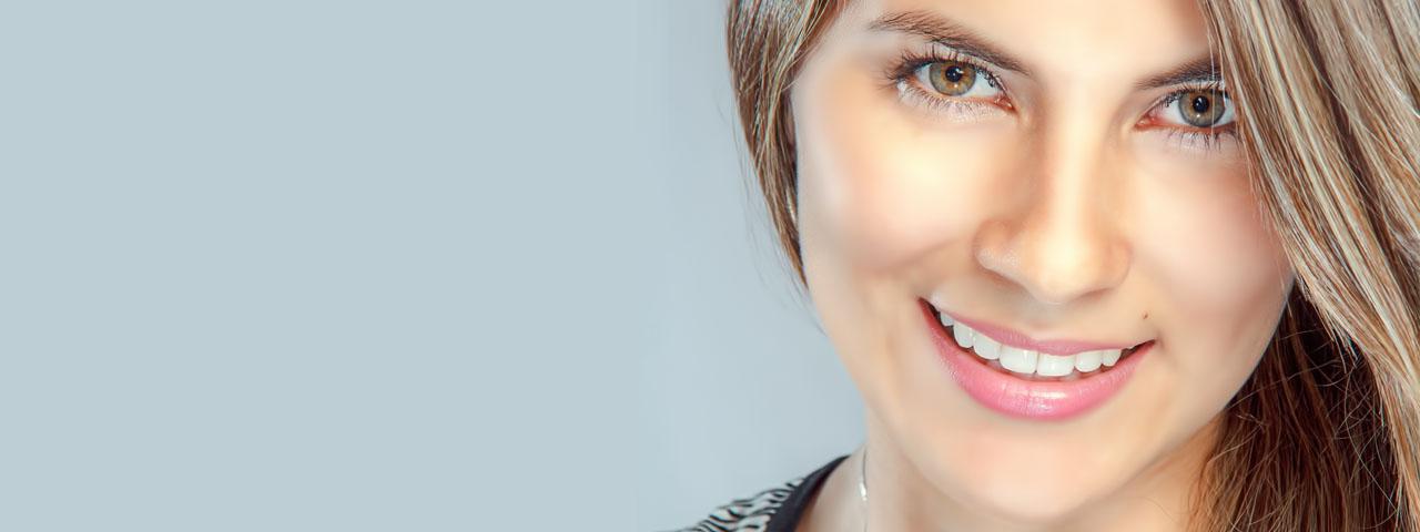 Woman Smiling Pretty Eyes in Saginaw and Hemlock, MI