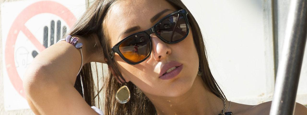 Woman wearing sunglasses in Hemlock and Saginaw, MI