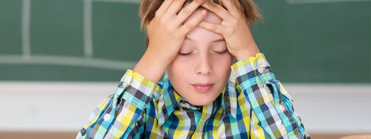 Boy, headache in Saginaw and Hemlock, MI