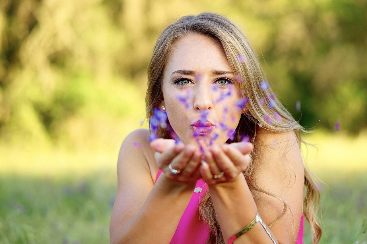 Female Blowing Purple Flowers1280x853