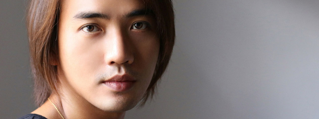 Asian youth, wearing contact lenses