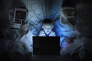 optometrist, little child using computer on the bed in Concord, NC