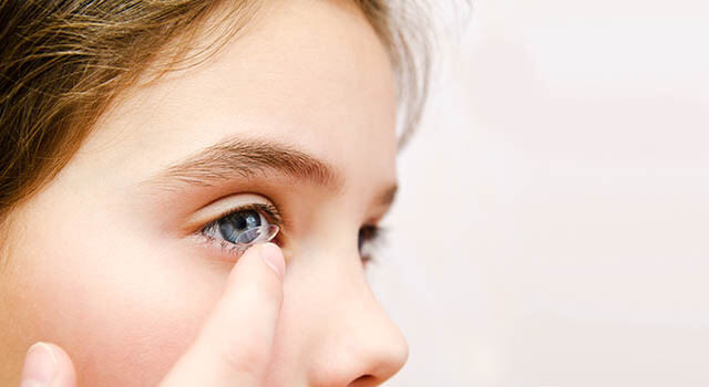 Girl inserting contact lens in Concord, NC