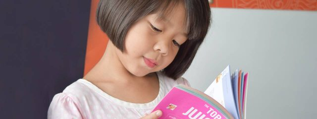 Eye doctor, little asian girl reading in Nesconset, NY