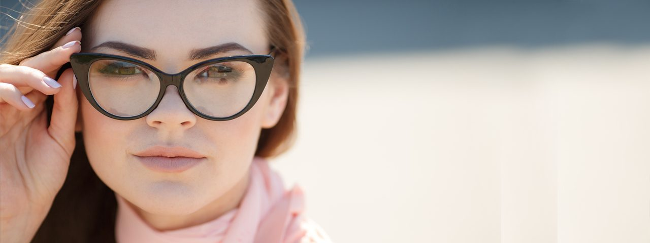 Eye doctor, woman wearing designer eyeglasses in Wentzville, Hillsboro, O'Fallon, Cottleville, MO