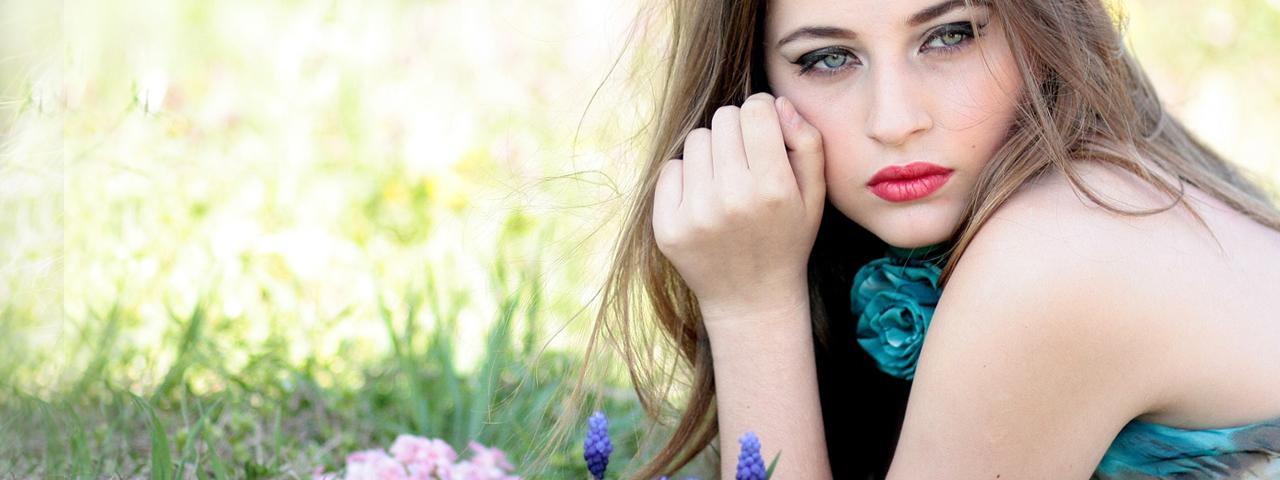 Beautiful blue-eyed woman in field