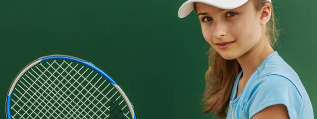 Eye care, girl holding a tennis racket in Calgary, AB