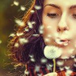 Eye care, woman with eye allergies blowing a dandelion in Merritt Island & Rockledge, FL