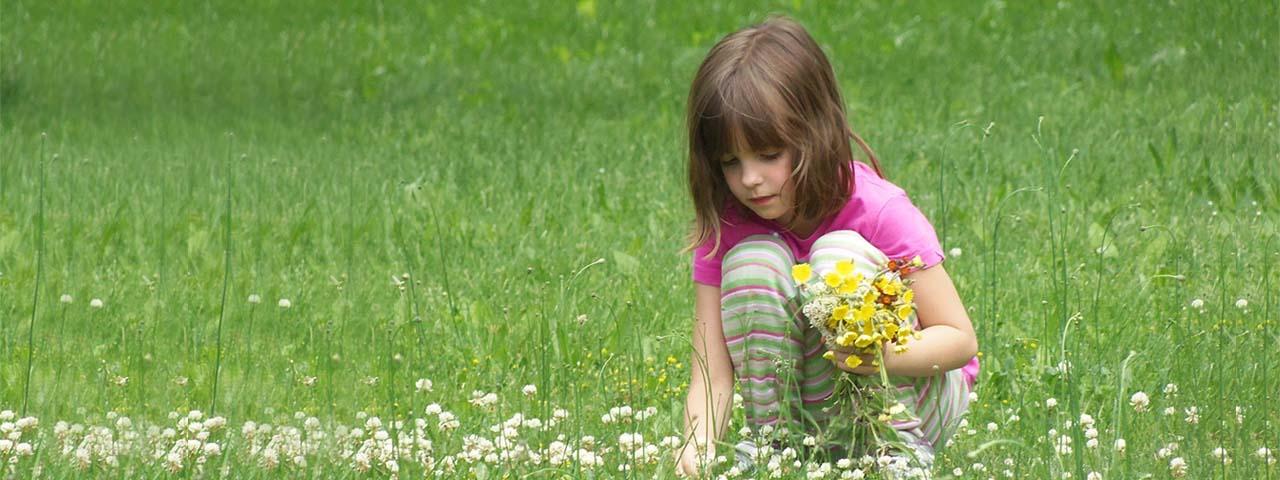 Eye Care ,Little girl picking flowers in Merritt Island & Rockledge, FL