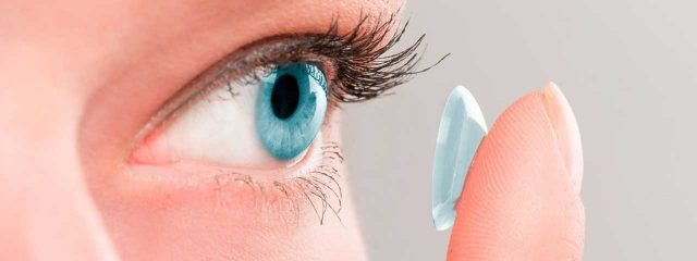 Eye doctor, woman putting on a scleral contact lens in Llano, Texas