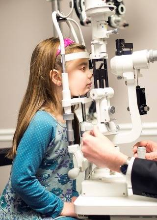 child having a pediatric eye exam in St. Louis