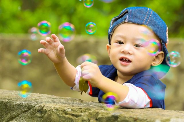 Optometrist, Baby Boy Playing with Bubbles in St. Charles, Missouri