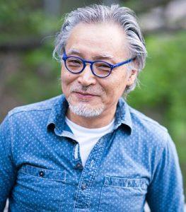 asian-man-blue-glasses-smile-r-263x300