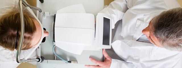 Doctor in eye exam, Birds eye view,