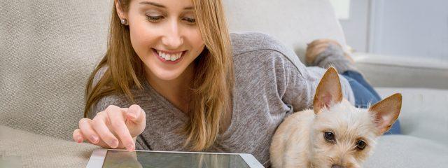 Optometrist, happy girl browsing her tablet in West Orange, NJ