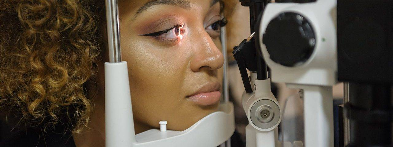 african american woman getting eye exam in hialeah gardens fl