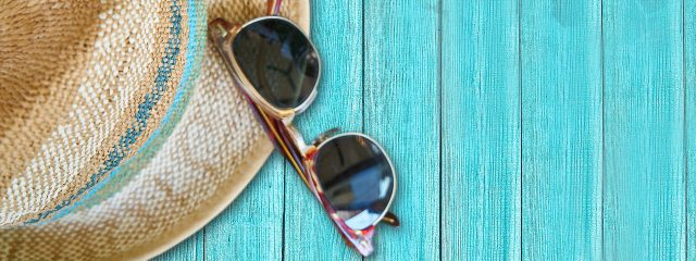 Eye doctor, pair of sunglasses on wooden surface in Redwood City, CA