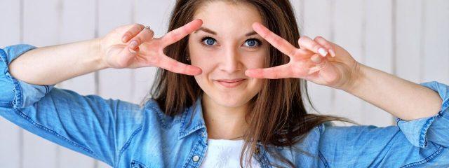 Eye doctor, happy girl wearing GP contact lenses in Redwood City, CA