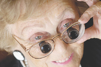 Optometrist, senior woman wearing low vision glasses in Bourbonnais, IL