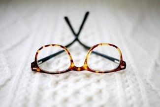 eyeglasses on white surface 325×217