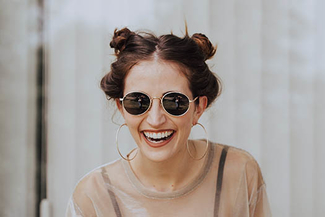 woman wearing sunglasses 325×217