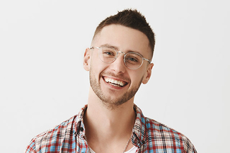 Cute Ordinary Caucasian Trendy Guy In Glasses Smiling Cheerfully