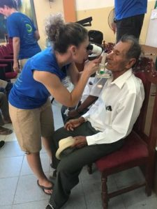 Volunteer Optometrist from Colorado Springs CO giving eye exam to patient in Peru