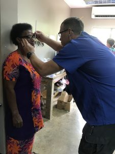 Eye doctor examening patient in Fiji