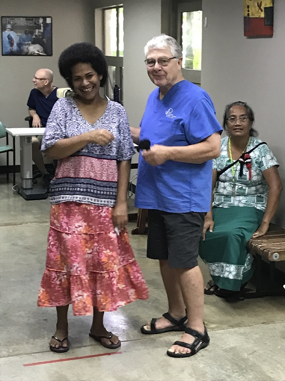 Optometrist and patients in Fiji