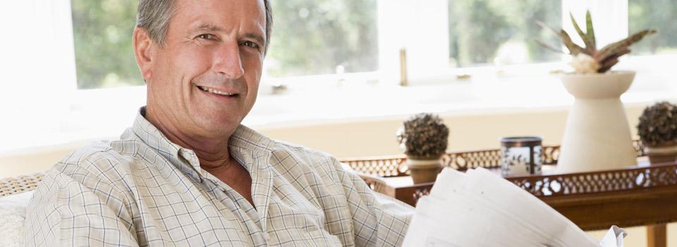 Older Man reading the newspaper in Colorado Springs, Colorado