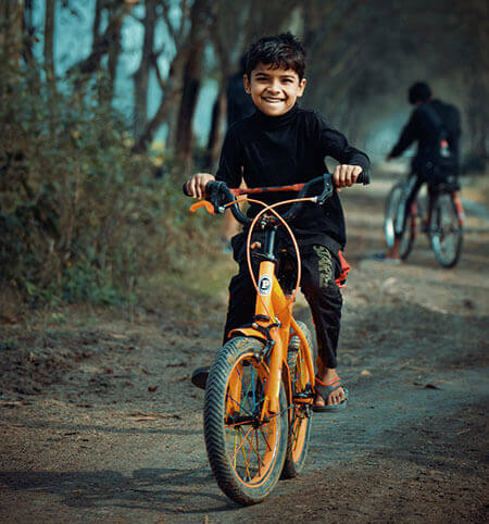 boy riding bicycle
