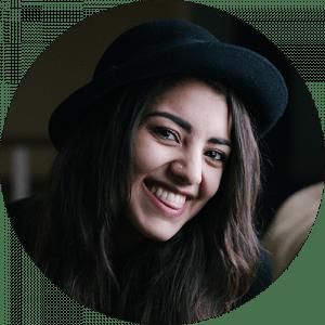 smile woman dark hat bkgnd