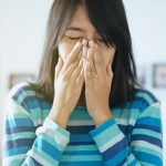 Optometrist, asian woman suffering from eye allergies in Morrisville, NC