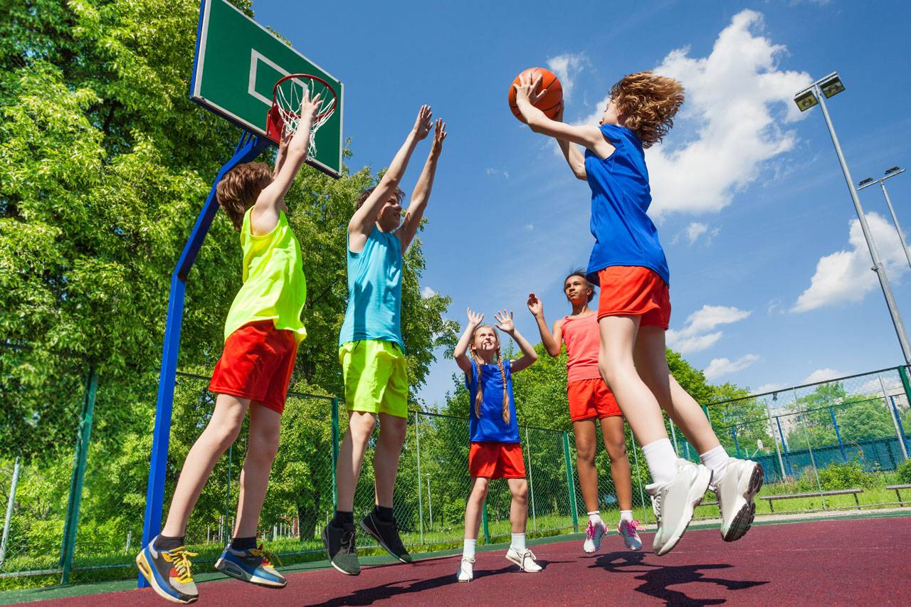 kids jumping and playing basketball, sports eyewear protection in Morrisville